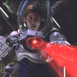 Lt. Cmdr. Kate Bowman (Carrie-Ann Moss) takes aim at director Antony Hoffman's crotch during the troubled production of Warner Bros. Red Planet